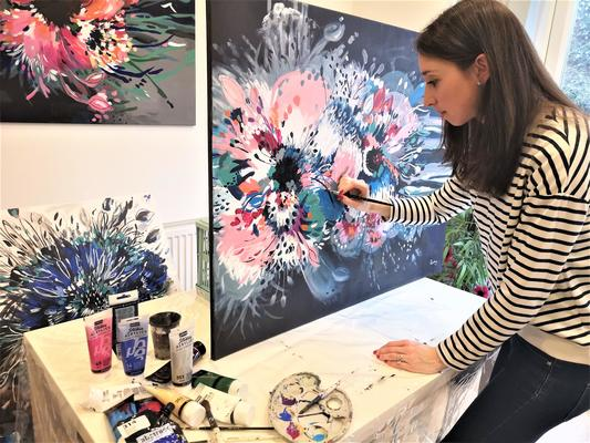 Abstract Artist Judy Century painting a large, vibrant, expressive hibiscus flower