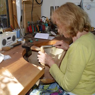 Working at my bench with a glimpse of part of my studio