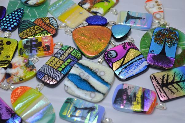 Original fused glass jewellery incorporating reactive and dichroic glass