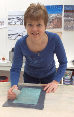 Artist Marian Hall screen printing in her home studio