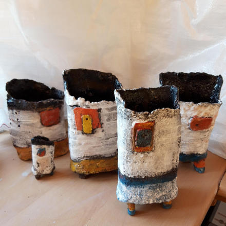 Colourful set of pots with legs.